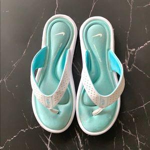 Nike comfort food bed flip flops.